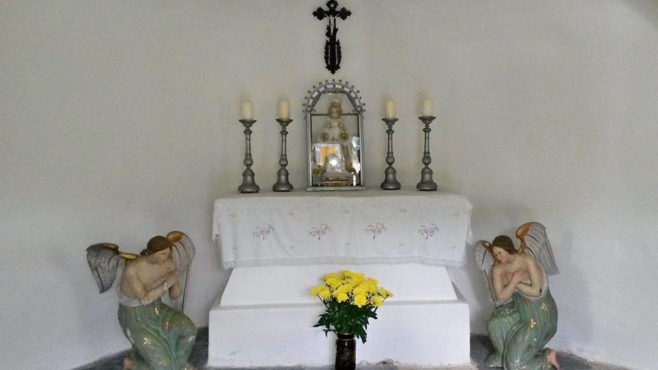 V kapli
