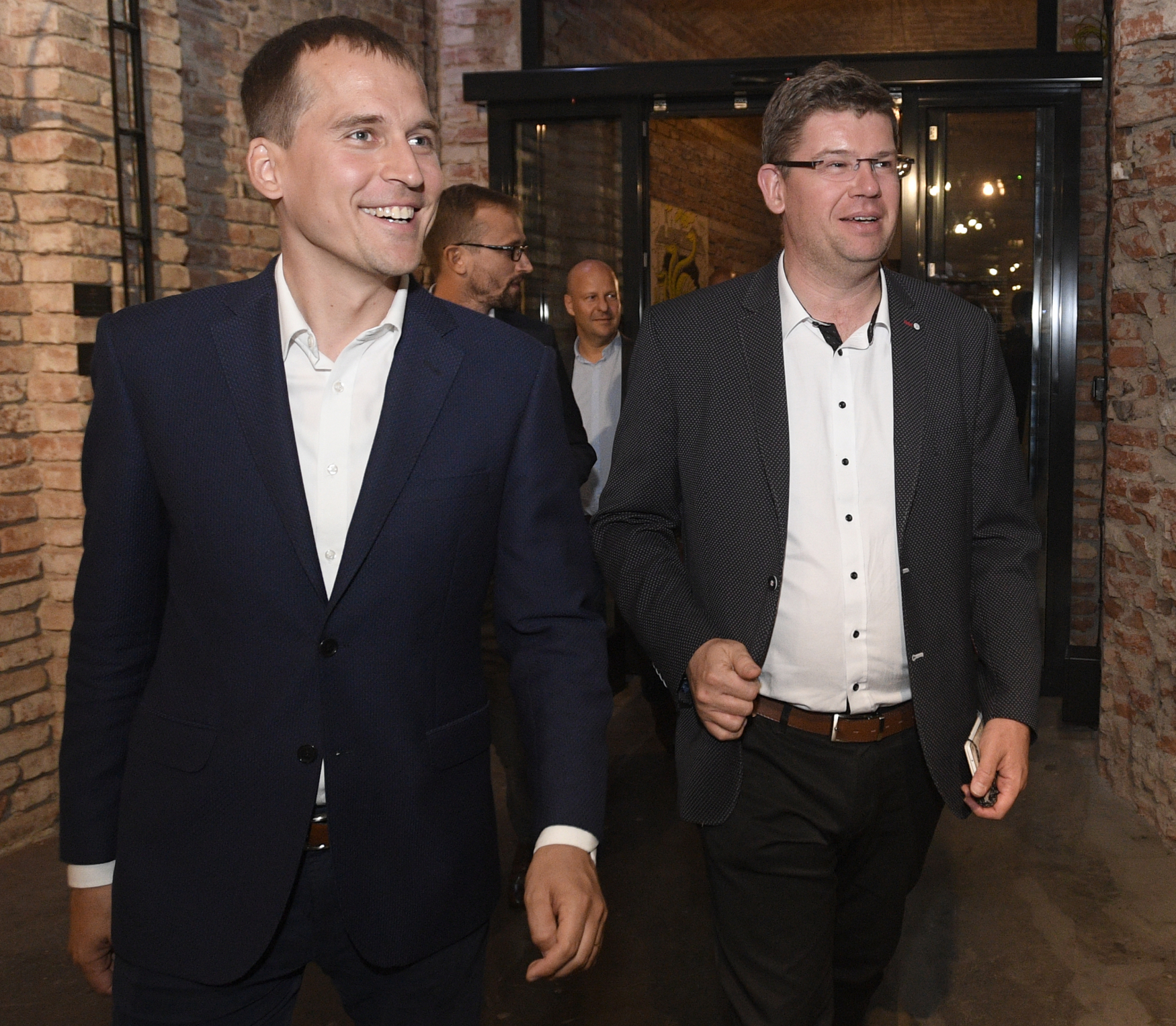 Lídr uskupení Praha Sobě Jan Čižinský (dříve KDU-ČSL) a lídr Spojené síly pro Prahu Jiří Pospíšil (TOP 09)